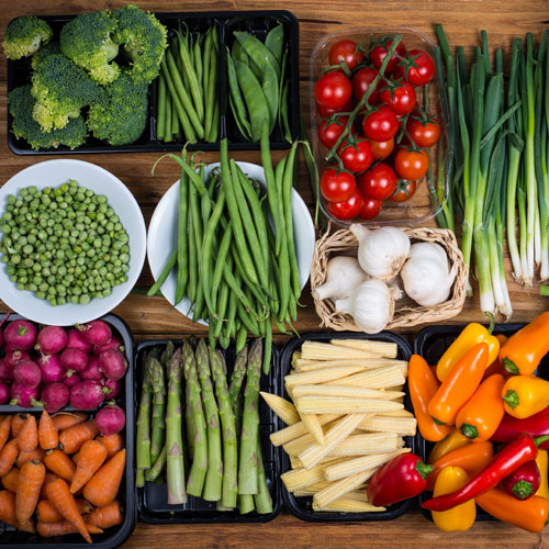 Assorted vegetables in colorful display.