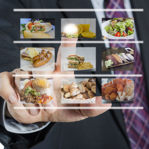 Patron using touch screen to select food options.